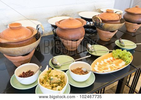 Old Clay Pot With On Food And Garnish