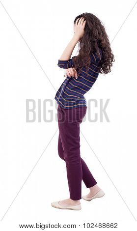 back view standing young woman. Rear view people collection. Isolated over white background.girl modest scratches his head in surprise. woman in red jeans thoughtfully scratching his curly hair