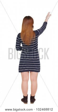 Back view of  pointing woman. beautiful girl. Rear view people collection.  backside view of person.  Isolated over white background. Girl shows two fingers of the hand to the top