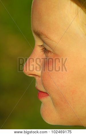 teen's face in profile