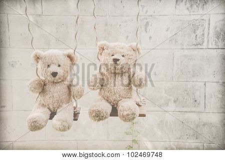 Teddybears on a swing