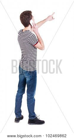 Back view pointing young men talking on cell phone. Young guy  gesture. Rear view people collection.  backside view person.  Isolated over white background. Curly guy on the phone tells what he saw