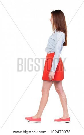 side view of walking  woman in red. beautiful blonde girl in motion.  backside view of person.  Rear view people collection. Isolated over white background.