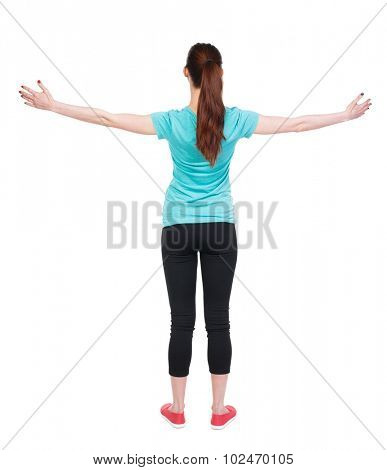 back view of standing young beautiful  woman in in sportswear  involved in Pilates. Rear view people collection.  backside view of person.  Isolated over white background.