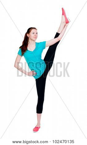 back view of standing young beautiful  woman in sport dress  involved in Pilates.   backside view of person.  Isolated over white background. Sport girl in black tights rose high leg warming up.