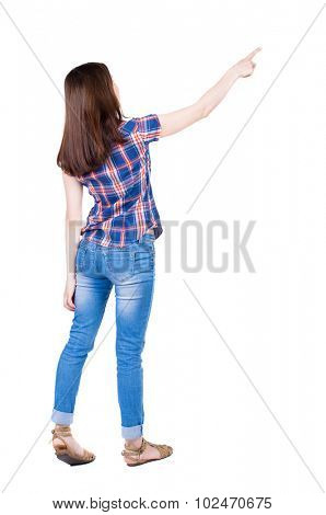 Back view of  pointing woman. beautiful girl. Rear view people collection.  backside view of person.  Isolated over white background. Girl in a blue plaid shirt with short sleeves indicates the right.