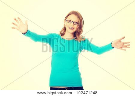 Cheerful teenage woman with arms wide open