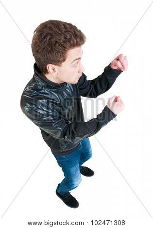 skinny guy funny fights waving his arms and legs. Isolated over white background. Top view of a fighting man. A guy in a black jacket in a street fight.