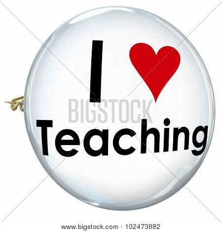 I Love Teaching with heart symbol on a white button or pin to illustrate feelings of a proud teacher at a school, college or other center of education and learning