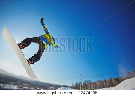 Man on snowboard enjoying extreme kind of sport on winter resort