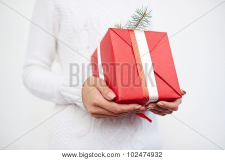 Giftbox with Christmas surprise in female hands