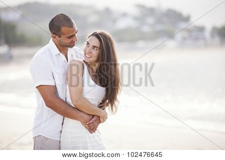 Passionate couple in love at the beach