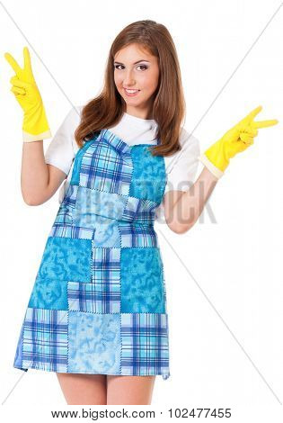 Young housewife with yellow gloves, isolated on white background