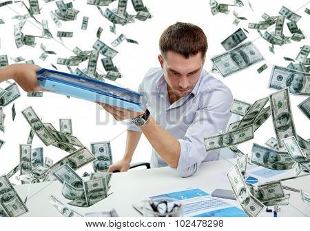 business, people and paperwork concept - businessman taking folder with papers from secretary over falling money background