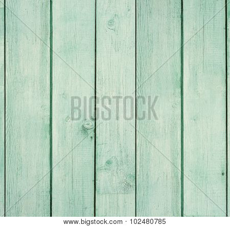 Old wooden board painted light green.
