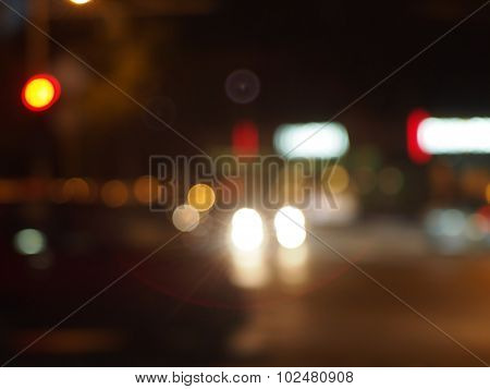 Blur And Defocused Lights From The Headlights Of Cars