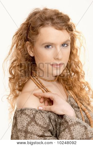Pretty Girl With Long Curly Hair Looking At Camera