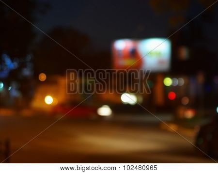 Abstract Night Scene With Dim Lights And Headlights