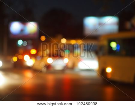 Defocused Lights From The Headlights Of Cars And Traffic Lights