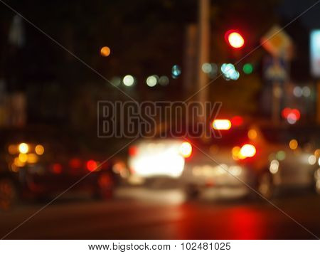 Blur And Defocused Lights On The Stream Of Cars