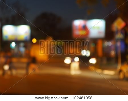 Abstract Urban Night Scene With Blurred Headlights On The Road
