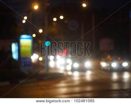 Defocused Lights On The Stream Of Cars And Traffic Lights