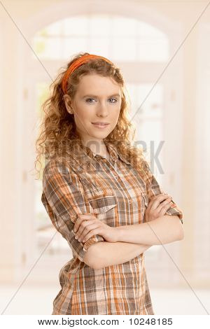 Portrait Of Pretty Young Girl At Home Smiling