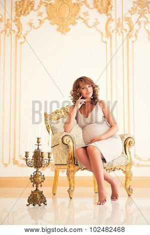 Fashionable Pregnancy. Future Beautiful Mother In An Expensive Interior