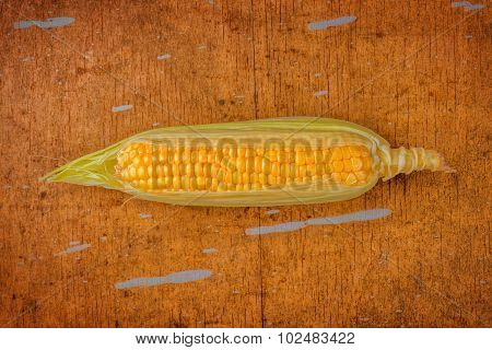 Corn Cob On Rustic Wooden Table
