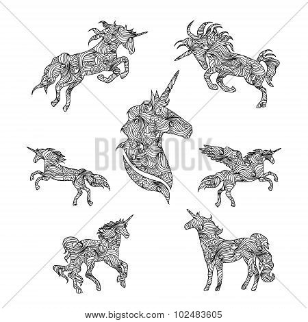 Set of black graphic unicorns.