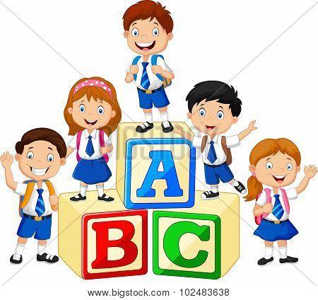 Happy school kids with alphabet blocks