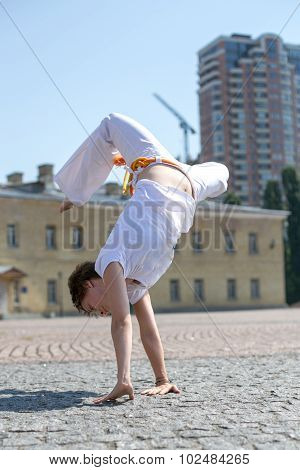 Young girl doing a somersault leaning on hands