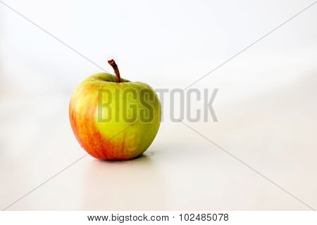 red and green apple on a white background