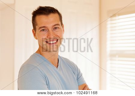 good looking young man in empty house