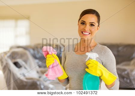 beautiful housewife doing housework in new home