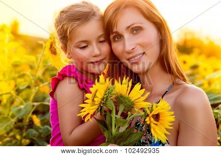 mother with daughter in the summerend