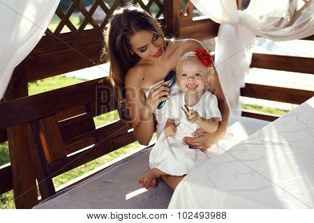 Gorgeous Mother Having Fun With Her Cute Little Daughter
