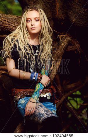 Romantic boho style girl in the wild wood. Boho, hippie fashion shot.