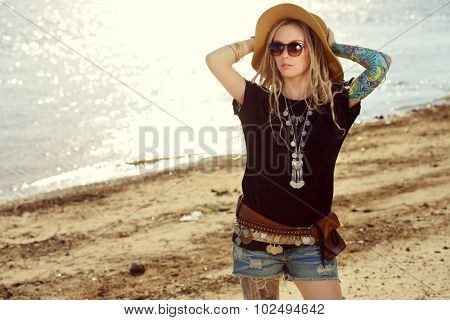 Romantic summer girl in boho style clothes walking along the riverside. Boho, hippie.