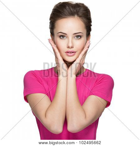 Portrait of a beautiful young woman with calm emotions and hands on face  -over white background