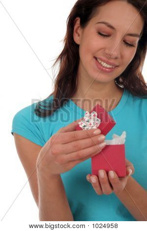 Happy Woman Opening Present