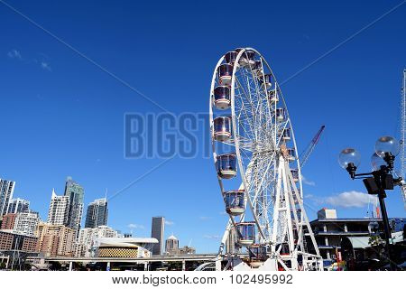 SYDNEY, AUSTRALIA - AUGUST 2015: Ferris wheel in Darling Harbour Sydney Australia.