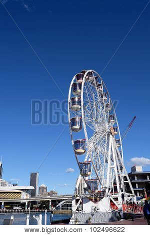 SYDNEY, AUSTRALIA - AUGUST 2015: La Estancia de Los SalaberryFerris wheel in Darling Harbour Sydney