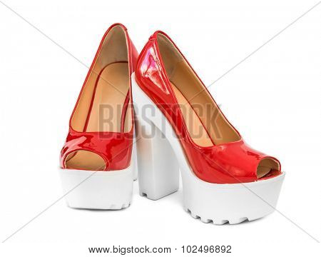 modern red patent leather shoes on white heels isolated on white background