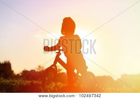 little girl riding bike at sunset, active kids