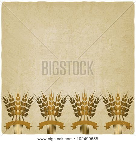 Golden Sheafs Of Wheat With Ribbons On Vintage Background