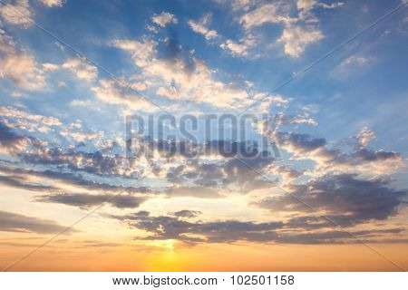 Amazing Sundown Sky with Beautiful Clouds and Sunbeams, natural background