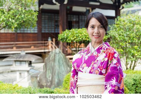 Woman in Japanese temple with kimono
