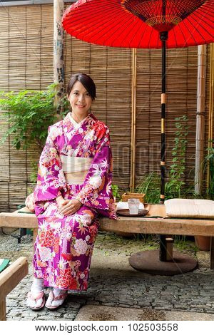 Woman with kimono dress and sitting in the tea house