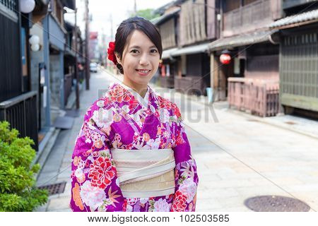 Japanese woman with traditional Japanese clothes in Kyoto